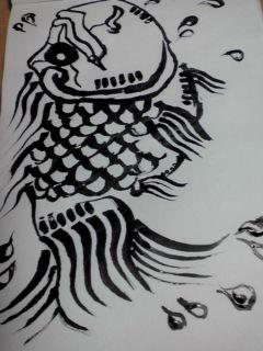 鯉の様な金魚の様なまな板の上の